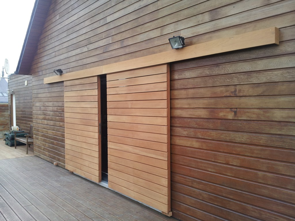 Menuiseries ext rieures arzal morbihan rge qualibat for Porte de garage coulissante bois
